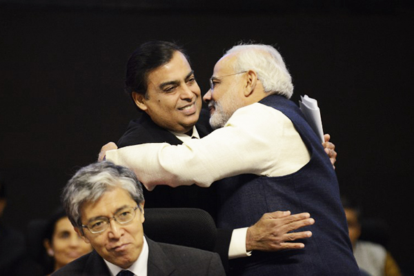 Ambani embraces Gujarat's Modi, Jan. 11. Sam Panthaky—AFP
