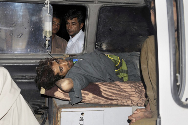 An injured Pakistani being ambulanced in Dalbandin, April 17. Banaras Khan—AFP