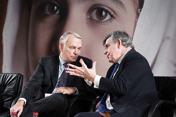 Brown with the French prime minister at the 'Stand Up for Malala' event on Dec. 10 in Paris. Bertrand Langlois—AFP
