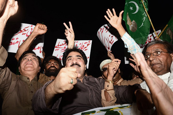 Musharraf supporters protest in Lahore, April 18. Arif Ali—AFP