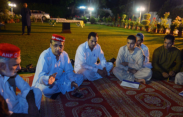 ANP leader Haroon Bilour meets party activists in Peshawar. A. Majeed—AFP