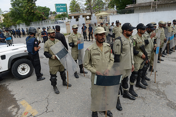Paramilitary soldiers deployed outside the anti-terrorism court where Pervez Musharraf's case was being heard. Farooq Naeem—AFP