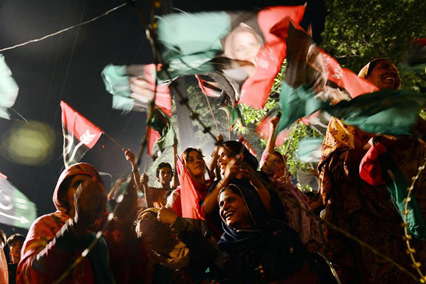 PPP supporters at an election rally in Lahore. Arif Ali—AFP