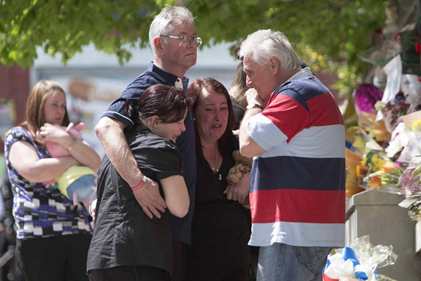 Lee Rigby's family mourns at the site of his attack. AFP