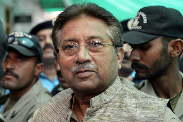 Former President Pervez Musharraf is escorted by soldiers, April 2013. Aamir Qureshi—AFP