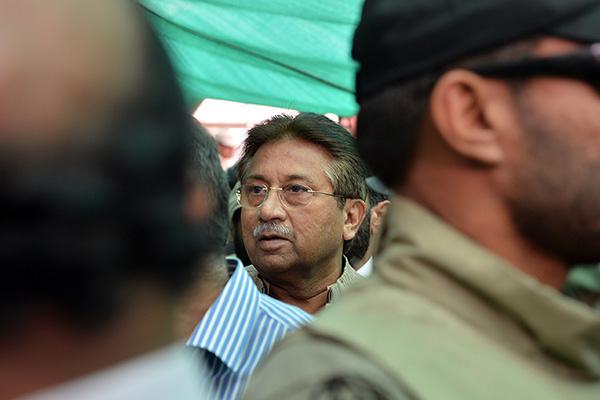 Soldiers escort Pervez Musharraf as he arrives for a court hearing in April, 2013. Aamir Qureshi—AFP