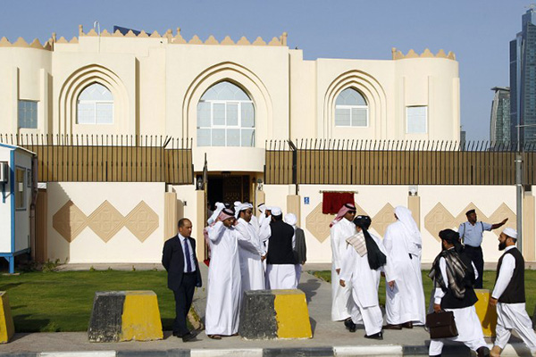 Guests arrive at the new Taliban political office in Doha, Qatar. Faisal al-Timimi—AFP