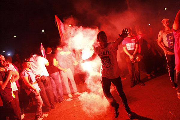Morsi's detractors celebrate his ouster. Mahmoud Khaled—AFP