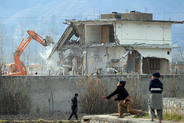 The demolition of Osama bin Laden's compound in Abbottabad, 2012. Aamir Qureshi—AFP