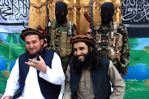 Adnan Rasheed (right) with former TTP spokesman Ihsanullah Ihsan. Haji Muslim—AFP