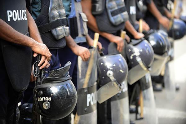 Bangladesh police stand guard during a protest called by the Jamaat-e-Islami. Munir Uz Zaman—AFP