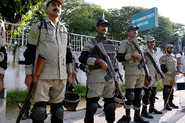 Paramilitary soldiers stand guard outside court during Musharraf's hearing. Aamir Qureshi—AFP