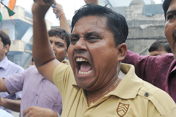 A demonstrator shouts anti-Pakistan slogans at a rally in India. Sam Panthanky—AFP