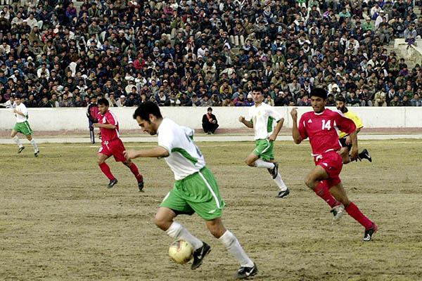 Turkmenistan takes on Afghanistan in a 2003 football match in Kabul. Shah Marai—AFP