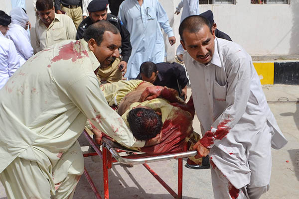 Police transport injured colleagues to a hospital in Quetta, August 2013. Banaras Khan—AFP