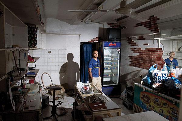 Hussain at his empty store in Athens, June 14, 2012. Nikos Pilos.
