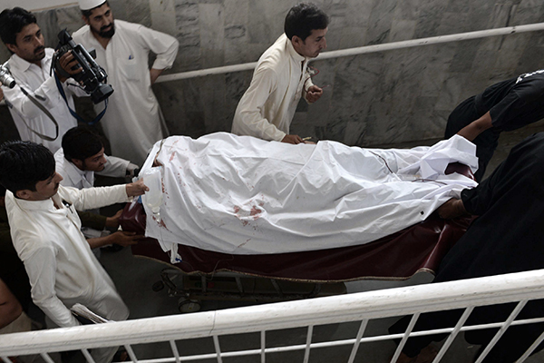 A female health worker being moved after an attack in Peshawar on May 28. A. Majeed—AFP