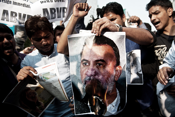 Protest outside Tehelka's office in New Delhi, Nov. 22. Manan Vatsyayana—AFP