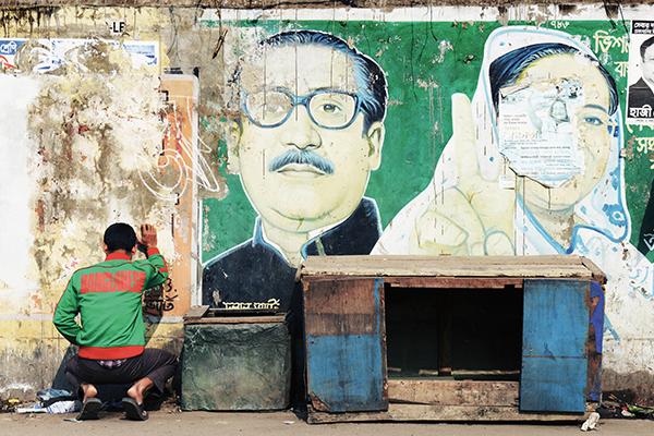 A man relieves himself in Dhaka, Jan. 3. Roberto Schmidt—AFP
