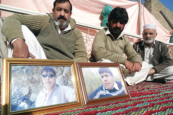 Aitzaz's father, Mujahid Ali (left), in Hangu. Basit Shah—AFP