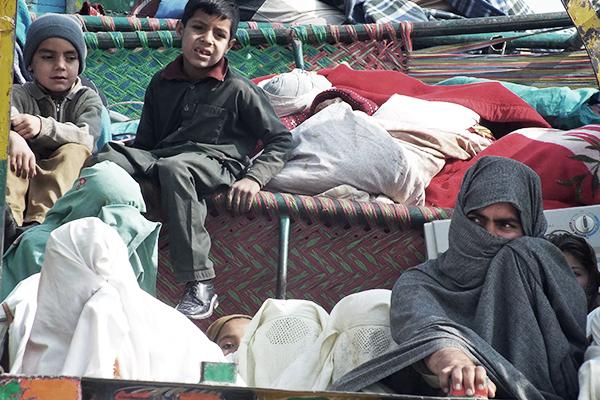 IDPs arriving in Bannu, Jan. 22. Karim Ullah—AFP