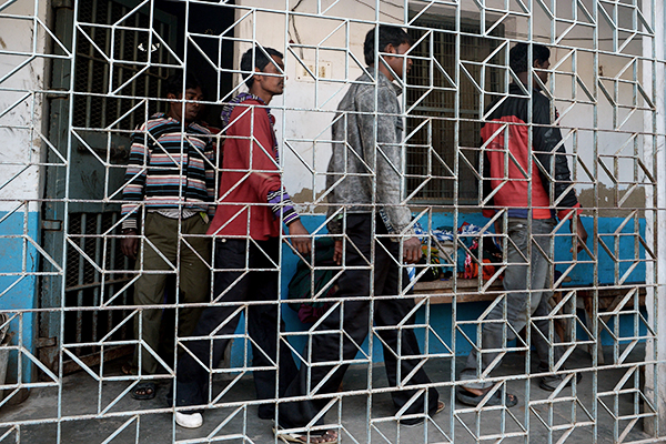 Gang-rape suspects being led to court in Bolpur, Jan. 24. Dibyangshu Sarkar—AFP