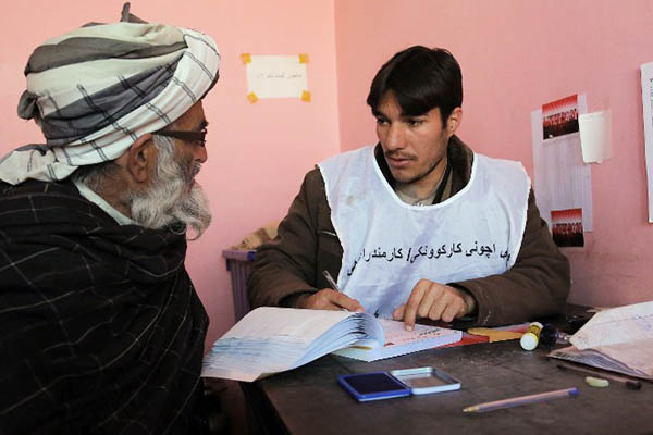 Registering to vote in the upcoming presidential elections. Rahmatullah Alizada—AFP