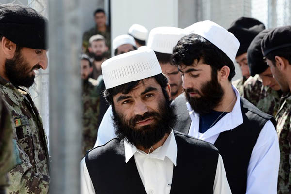 Afghan detainees waiting to be released from Bagram jail, 2013. Massoud Hossaini—AFP
