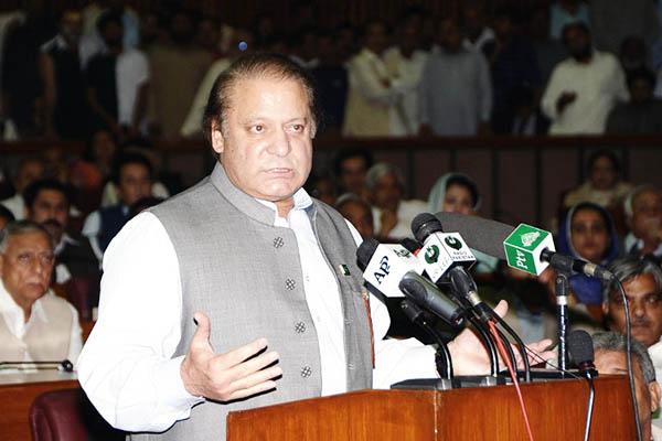 Prime Minister Nawaz Sharif addresses the National Assembly, June 2013. AFP