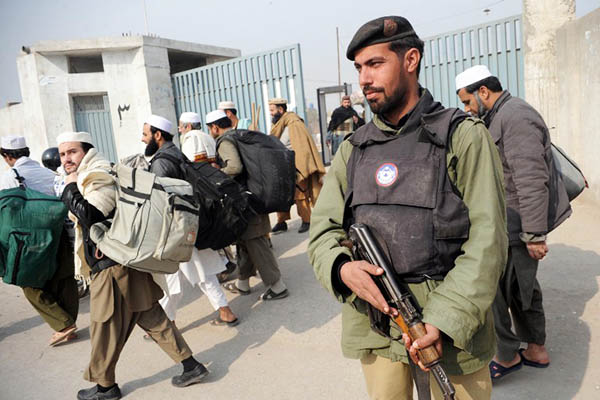 A policeman stands guard outside the Tableeghi Markaz in Peshawar. A. Majeed—AFP