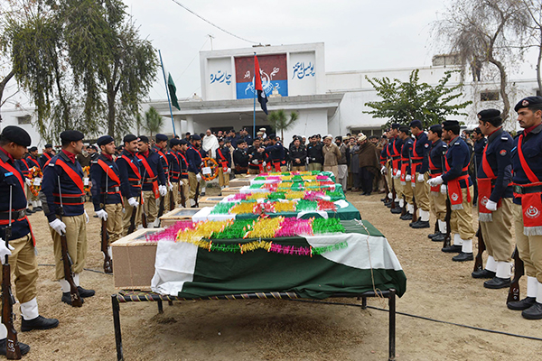 Funeral for policemen killed last month in Charsadda. A. Majeed—AFP