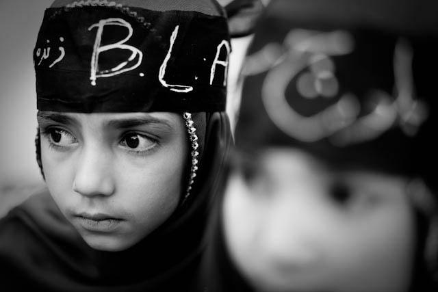 Two Baloch girls wear Baloch Liberation Army bandanas during a demonstration in Quetta. Photograph by Marc Wattrelot