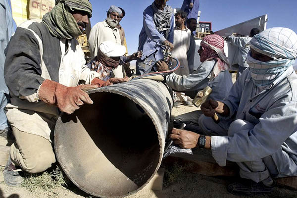 Workers repair a damaged pipeline after its was blown up by suspected tribal rebels in Mastung, 2006. Banaras Khan—AFP