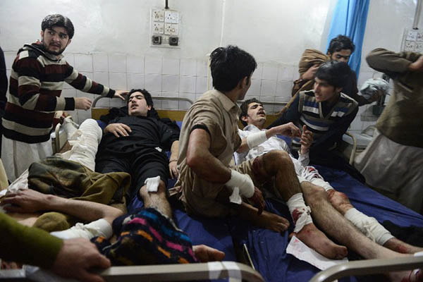 Victims of a bombing in Peshawar, February 2014. Hasham Ahmed—AFP