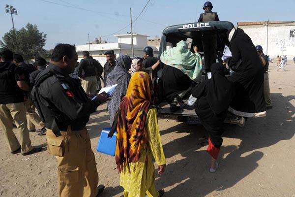 Police escort a polio vaccination team. Rizwan Tabassum—AFP