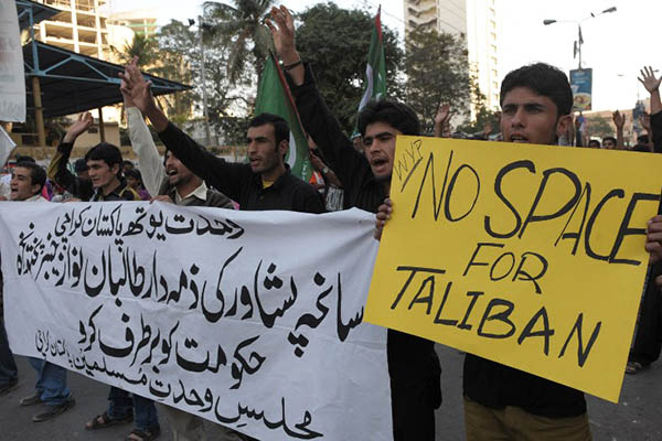 A protest against the ongoing peace talks in Karachi. Rizwan Tabassum—AFP