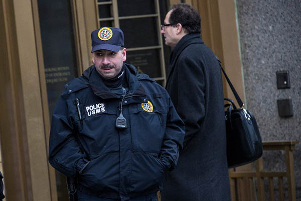 A security guard stands outside the federal court where Abu Gaith is testifying. Andrew Burton—AFP