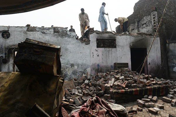 The remains of a house burnt to the ground by a mob in Lahore, March 2013. Arif Ali—AFP
