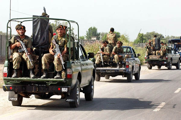 Pakistani troops patrol the tribal areas, June 2008. Tariq Mahmood—AFP