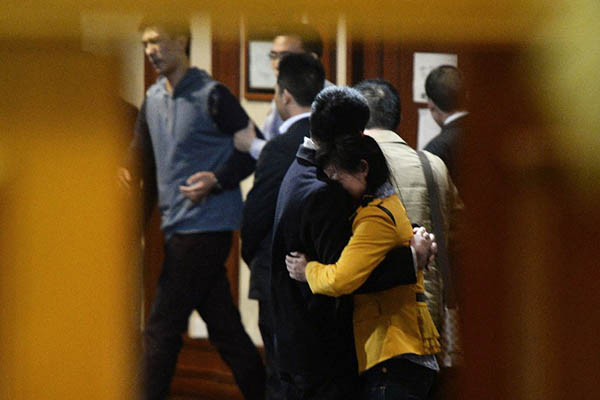 Relatives of passengers onboard MH370 grieve after being informed of the plane crash. Mark Ralston—AFP
