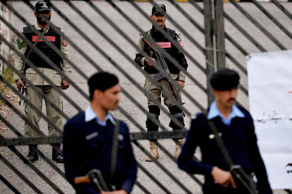 Guards outside the special court set up to try former president Pervez Musharraf. Aamir Qureshi—AFP