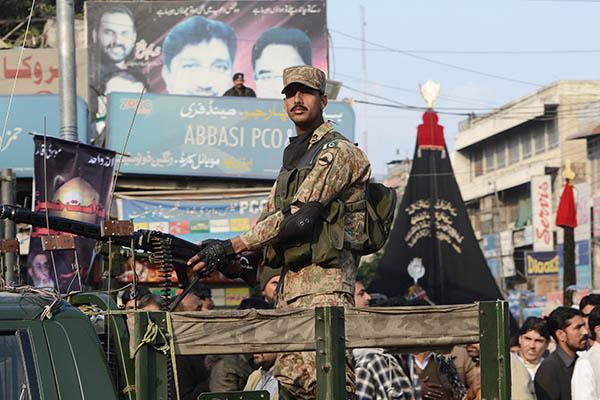 A Pakistan Army vehicle patrols Rawalpindi. Farooq Naeem—AFP