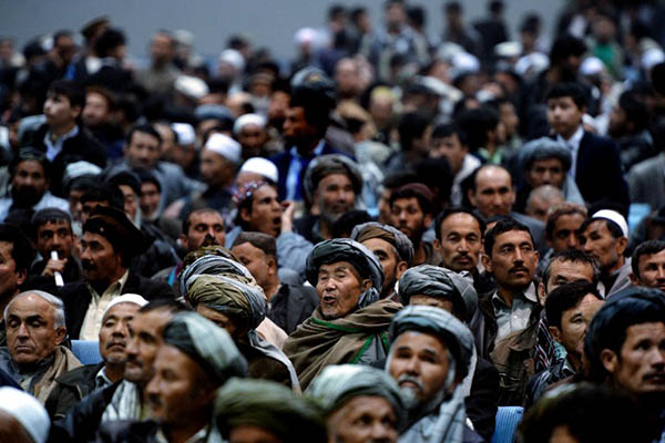 Afghans fill a local hall in Kabul to listen to presidential candidates. Wakil Kohsar—AFP