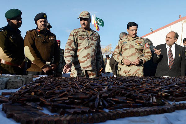 FC officials display seized arms and ammunition during a media briefing, January 2014. Banaras Khan—AFP