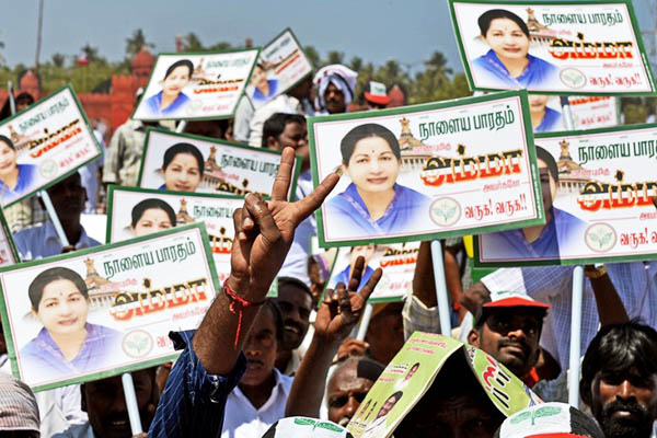 AIADMK supporters wave placards ahead of a public meeting in Pondicherry. Manjunath Kiran—AFP