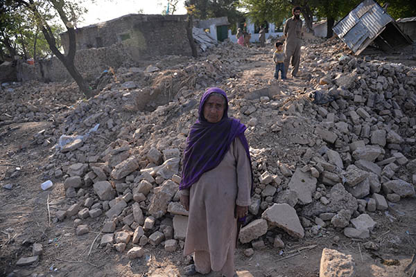Mirjan stands in front of the rubble that used to be her house. Aamir Qureshi—AFP