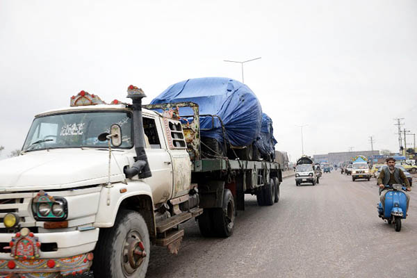 Container trucks transporting supplies for NATO forces. A. Majeed—AFP