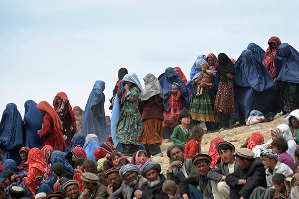Survivors wait for aid in Badakhshan province. Farshad Usyan—AFP