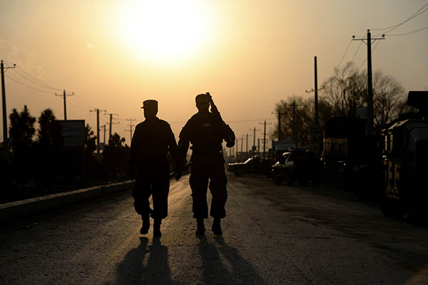 Afghan policemen on patrol after an insurgent attack. Wakil Kohsar—AFP