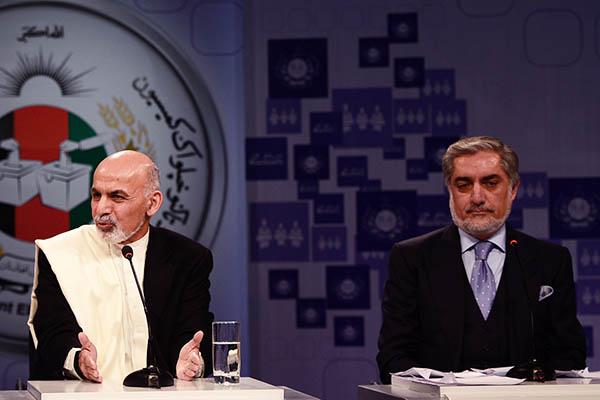 Ashraf Ghani (left) and Abdullah Abdullah at a debate. Wakil Kohsar—AFP